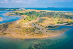 Aerial view of golf island from above Malahide harbour in Dublin county, Ireland. Beach aerial view on the irish coast.