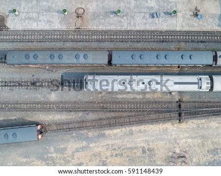 Aerial view of goods train and railway track - Diesel Engine train. Top view of DIESEL LOCOMOTIVE.