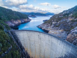 Aerial view of Gordon Dam and lake. Southwest, Tasmania, Australia