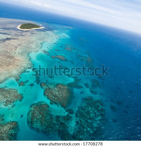 Aerial view of Great Barrier Reef with clear blue water, Queensland, Australia