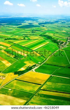 Aerial view of green rural landscape under blue sky
