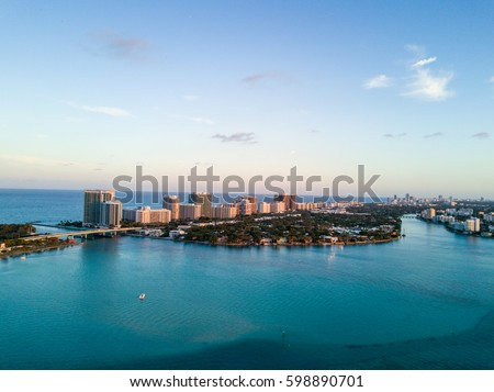 Aerial view of Halouver sandbar, boats and tip of Bal Harbour  in Miami, Florida.