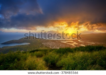 aerial view of Hanauma Bay and Diamond Head at sunset from a top of Koko Head Crater, Oahu, Hawaii, USA