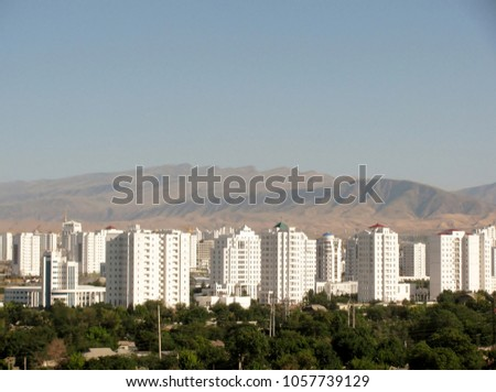 Aerial view of high-rise office buildings residential and Kopet Dag mountain range Ashgabat. Turkmenistan