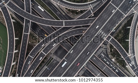 Aerial view of highway and overpass in city on a cloudy day #1012974355
