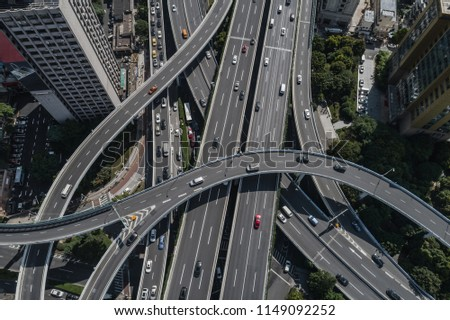 Aerial view of highway and overpass in city on sunny day #1149092252