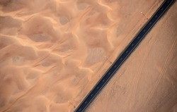Aerial view of highway road in the desert