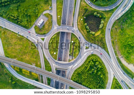 Aerial view of highway road junction. Highways, railway and green fields on the outskirts of the city. Transport concept. #1098295850