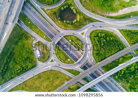 Aerial view of highway road junction. Highways, railway and green fields on the outskirts of the city. Transport concept. #1098295856