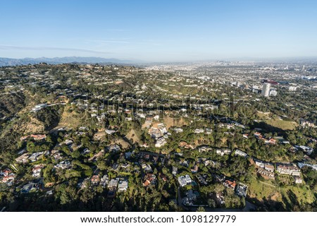 Aerial view of hillside and canyon homes above Beverly Hills, West Hollywood and Los Angeles in scenic Southern California.