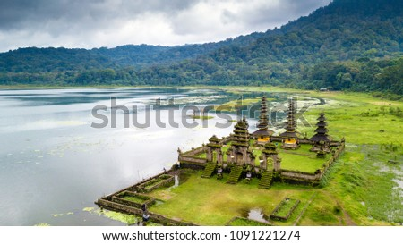 Aerial view of hindu temple ruins of Pura Hulun Danu at the Tamblingan lake, Bali, Indonesia