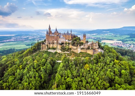 aerial view of Hohenzollern Castle on mountain top, old German burg in summer, Germany. This castle is famous landmark in Stuttgart vicinity. Swabian landscape with fairytale Gothic castle like palace
