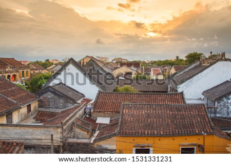Aerial view of Hoi An town with many old tile roof in beautiful sunset. Hoi An is the World's Cultural heritage site, famous for mixed cultures & architecture.