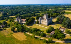 Aerial view of impressive medieval castle of Chateau de Roquetaillade in green valley in Mazeres near Bordeaux, France