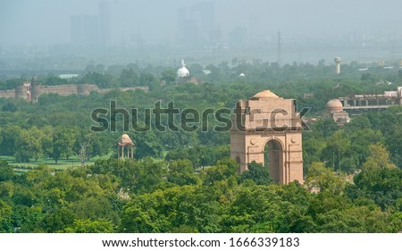 Aerial view of INDIA GATE  with massage GREEN DELHI - CLEAN DELHI in the stand between the tree in New Delhi India.