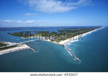 Aerial view of Indian River Lagoon Scenic Highway on Melbourne Beach, Flordia with inlet and pier.