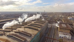 Aerial view of industrial steel plant. Aerial sleel factory. Flying over smoke steel plant pipes. Environmental pollution. Smoke.