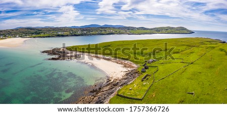 Aerial view of Inishkeel Island by Portnoo next to the the awarded Narin Beach in County Donegal, Ireland - Monk building remains. Stok fotoğraf ©