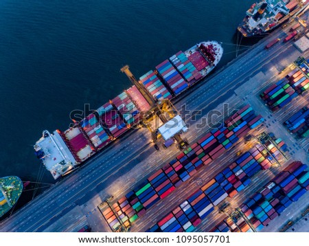Aerial view of international port with Crane loading containers in Container ship in import export and business logistics with crane and Shipping cargo. #1095057701