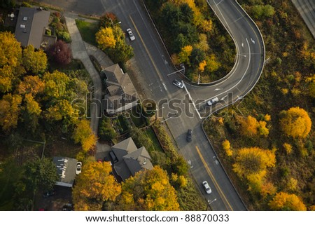 Aerial view of interstate exit surrounded by yellow trees