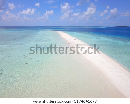 Aerial view of island white sand beach sandbank surrounded by shallow lagoon turquoise water in Maldives #1194641677