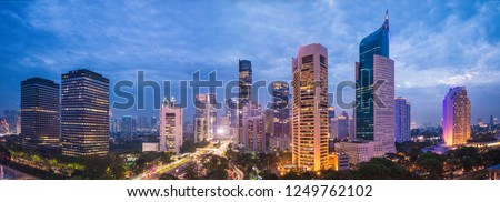 Aerial view of Jakarta's Central Business District at dusk (blue hour). Jakarta cityscape at sunset. A panorama stitched from 3 photos. Jakarta cityscape. Widescreen photo. #1249762102