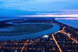 Aerial view of Jurmala along Lielupe river sunset twilight