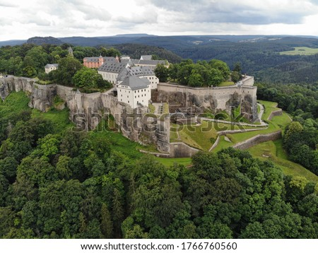 """Photo of  Aerial view of Königstein Fortress the """"Saxon Bastille"""", a hilltop fortress near Dresden, in Saxon Switzerland, Germany, It is one of the largest hilltop fortifications in Europe."""