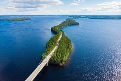 Aerial view of Karisalmi bridge on Pulkkilanharju Ridge at lake Paijanne, Paijanne National Park, Finland.