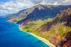 Aerial view of Kauai's rugged Nāpali Coast, where Kauai's remote tropical coastline meets the Pacific Ocean; Kauai, Hawaii