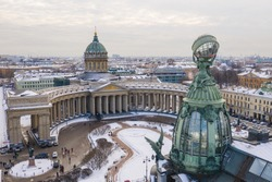 Aerial view of Kazan Cathedral in clear winter day, a copper dome, gold cross, colomns, Nevsky prospect, Zinger's Building, Griboyedov Canal, staff apartments vk.com, vkontakte