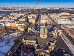Aerial view of Kazan Cathedral in clear winter day, a copper dome, gold cross, colomns, Nevsky prospect, Zinger's Building,  city panorama, Griboyedov Canal, staff apartments vk.com, vkontakte