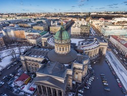Aerial view of Kazan Cathedral in clear winter day, a copper dome, gold cross, colomns, Nevsky prospect, Zinger's Building, Griboyedov Canal, staff apartments vk.com, vkontakte, Herzen's university