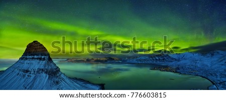 Aerial view of Kirkjufell mountain with beautiful aurora borealis in winter, Iceland. One of the famous natural heritage in Iceland.