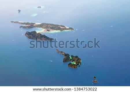 Aerial view of Koh Phi Phi Don and Koh Phi Phi Ley with the small islands around : Yung (Mosquito Island), Mai Phai (Bamboo Island), Bida Nai and Bida Nok.