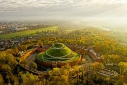 Aerial view of Kosciuszko Mound in autumn, foggy morning in Krakow, Poland