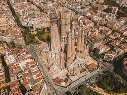 Aerial view of La Sagrada Familia in Barcelona, Antoni Gaudí's renowned unfinished church, in Catalonia, Spain. Drone photography of cathedral designed by Gaudi, Catalogna birds eye.