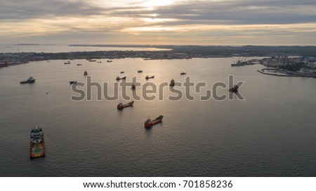 Aerial view of Labuan anchorage area during sunset. With a lots of vessel anchored, a place best known as an offshore financial centre offering international financial and business services.