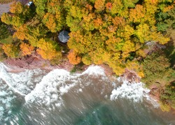 Aerial view of lake superior shore with autumn trees in Michigan upper peninsula
