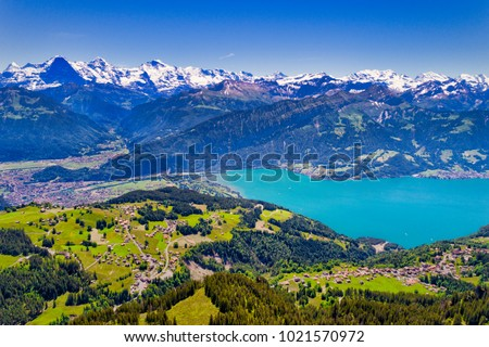 Aerial view of Lake Thun and Bernese Alps including Jungfrau, Eiger and Monch peaks from the top of Niederhorn in summer, Canton of Bern, Switzerland.
