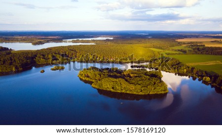 Aerial view of lakes in South Bohemia. Dvoriste pond with island in the evening. Popular recreational region, Czech republic, European union. Stock photo ©