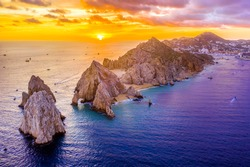 Aerial view of Land's End, Cabo San Lucas, Mexico at sunset, Baja California Sur, with the Cabo San Lucas marina in the background