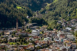Aerial view of Landeck dominated by Landeck Castle, the emblem of the city of Landeck, Austria, on a sunny day