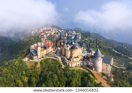 Aerial view of landscape is castles covered with fog at the top of Bana Hills, the famous tourist destination of Da Nang, Vietnam. Near Golden bridge.