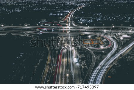 Aerial view of landscape perfect night road, top view at night traffic long exposure. color tone effect.