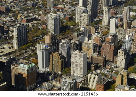 Aerial view of large city with downtown buildings.