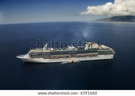 Aerial view of large cruise ship in Hawaiian waters.