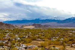 Aerial view of Leh city located in Ladakh, India from Leh palace. Natural beauty of Ladakh India. Snow mountains of Ladakh. Peak views of Himalayan range. You can see Snow & dusty mountains in Ladakh.