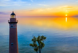 Aerial view of Little Sable Point Lighthouse at sunset over Lake Michigan; Mears, Michigan; Silver Lake State Park