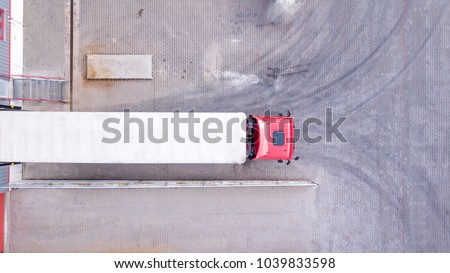 Aerial View of Loading Warehouse with Semi Truck. Aerial